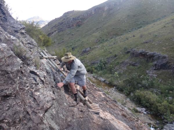 John climbing mountain goat style